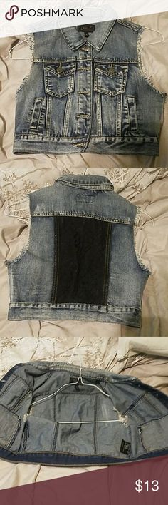 Crop sleveless jean jacket This jean button up can be thrown on over any top and look good. Ive worn this twice, this is good if your schools dress code is strict on straps or if you just want something ti spice up your favorite outfit. Tops