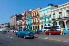 Picture of old classic cars and taxis on street in downtown city of Havana, Cuba