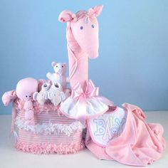 This impressive baby shower gift and/or baby shower centerpiece in pink for newborn baby girl. See our huge selection of baby girl gifts and diaper cakes today. Baby Shower Songs, Baby Shower Parties, Baby Shower Gifts, Diaper Parties, Pink Diaper Cakes, Unique Diaper Cakes, Newborn Diapers, Baby Shower Diapers, Unique Baby Shower Cakes