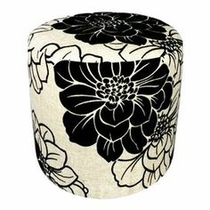 """This pouf showcases a simple silhouette wrapped in contrasting floral-print.     Product: Pouf Construction Material: Wood and canvasColor: Ivory and blackFeatures: Floral motifDimensions: 16"""" H x 17"""" Diameter"""