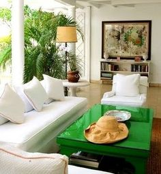 Green coffee table, white furniture, open air architecture.