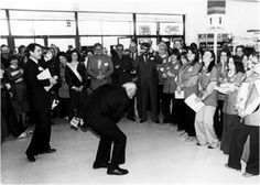 This is a picture of Sam Walton leading the Wal-Mart cheer. I work for Wal-Mart and have a great respect for what Sam Walton started. Even though the Wal-Mart cheer is super awkward, it puts us all in a good mood :)