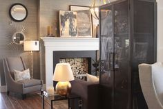 alice lane home collection | demian armoire, steel cabinet, grasscloth wallpaper, layered art, fireplace, gold lamp