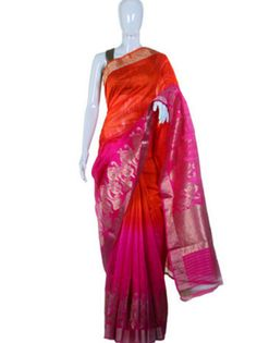 This trendy orange -pink Benarasi saree is perfect for the wedding occasion. The shimmery artwork on pallu makes this saree look graceful and apt for a grand wedding affair. Shop for such more stylish sarees online @ RedPolka
