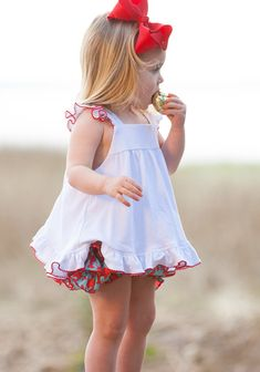 This will be your little one's go-to top this summer! Pair this sweet knit shirt with our Lobster Ruffle Bloomers for the cutest outfit around, see size guide. (runs gernerous!)