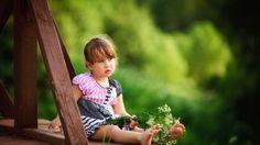 Cute Flower Girl Sit on Fringe