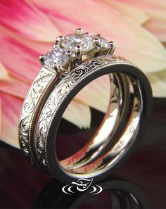 Custom 14kt warm white gold flat profile wedding band with scroll engraving to match GLJW made engagement ring