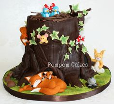 An eighth birthday cake for my daughter and her friend who shared a birthday party. Half chocolate cake and half lemon cake. Adapted from a Debbie Brown design. Woodland Cake, Woodland Theme, Woodland Party, Woodland Animals, Tree Stump Cake, Rodjendanske Torte, Fox Cake, Fondant Animals, Tree Cakes
