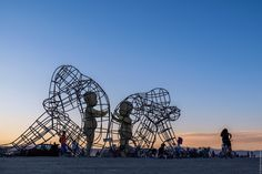 For Burning Man, Ukrainian artist Alexander Milov produced a large wire-frame sculpture featuring children within the shell of adults. Burning Man Sculpture, Burning Man Art, Sculpture Art, Touching Hands, Travel Europe Cheap, Colossal Art, Wire Frame, Cat Sitting, Travel Alone