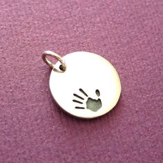 Sterling Silver Circle Stamping Blank Charm With Hand by Orodoro, $14,00