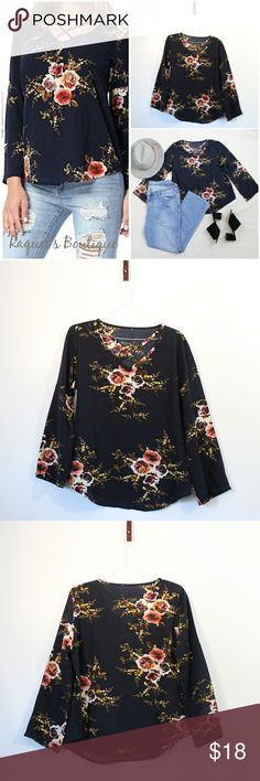 Belinda Floral Top in Navy Details: Floral long sleeve top with criss-cross neckline design   Brand: Boutique Brand  Size: Medium Measurements: Bust/32-34 inches Length/23.5 inches  Size: Large Measurements: Bust/34-36 inches Length/24 inches  Condition: New and packaged with boutique tags Tops