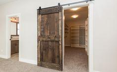 CCS Homes | Iowa Home Builder | Alan Sprinkle Barnwood sliding door to master closet