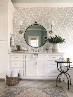 This leaf wallpaper is simply enchanting. A distressed print adds a sparkling brilliance to each leaf, like gazing into the night sky on a secluded beach alcove. The flowing pattern creates stunning movement within the design. Grande Armoire, Modern Bathroom, Mirror Bathroom, Beach Mirror, Bathroom Ideas, Downstairs Bathroom, Beautiful Bathrooms, Bathroom Furniture, Wall Paper Bathroom