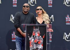 Mariah Carey Photos - Lee Daniels (L) and Mariah Carey speak onstage at the Mariah Carey Hand and Footprint Ceremony at TCL Chinese Theatre on November 1, 2017 in Hollywood, California. - Mariah Carey Hand and Footprint Ceremony