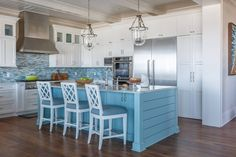beach house kitchen with turquoise blue island
