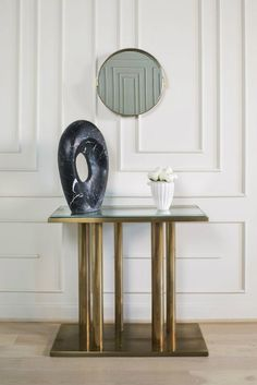 Best projects with modern console tables. Get inspired with Kelly Wearstler and find the best ways to decorate console tables with wallpaper, flowers among others home accessorizes.  http://modernconsoletables.net/modern-console-tables-kelly-wearstler/