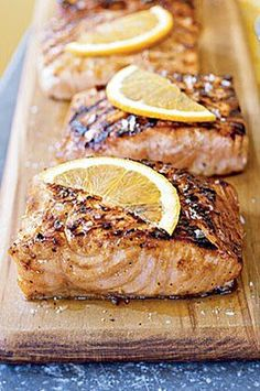 The sweet-sour marinade is cooked down to a syrupy glaze that's brushed on the salmon as it cooks. The citrus and maple flavors would also be tasty with pork. Garnish fillets with orange slices, if desired.#salmon #seafood #salmonrecipes #salmondishes Barbecue Recipes, Grilling Recipes, Seafood Recipes, Crockpot Recipes, Seafood Dishes, Dinner Recipes, Grilled Salmon Recipes, Tilapia Recipes, Cheeseburger Recipe