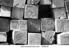 Pile of lumber from the cross section.  Building material at a construction site.  Black and white shot by Jose Gil, via ShutterStock