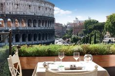 10 incredible hotel rooftops - Rome Italy - Have breakfast on the rooftop terrace while looking right at the Colosseum