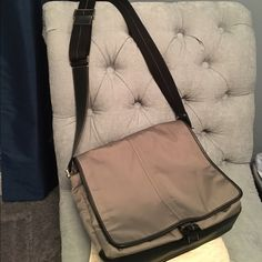 Gray Coach messenger bag/laptop bag This gray messenger bag has multiple compartments to hold school supplies or your personal items for a short overnight stay. Masculine look but I used it to carry my laptop in grad school. Authentic Coach bag Coach Bags Laptop Bags