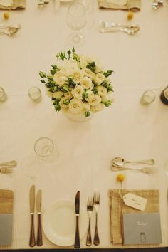 Table linen from Table Art - White Sheer Stripe overlay with Natural Spoke Linen Napkins.  Flowers by Kate Hill.  Photography by Jonathan Ogg