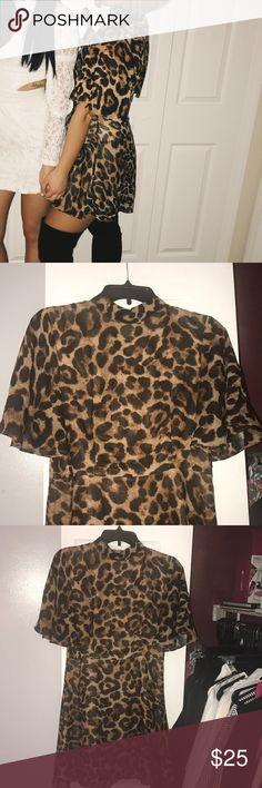 Nasty Gal Leopard dress worn once! Nasty Gal leopard dress! Worn once! Flutter sleeve Nasty Gal Dresses