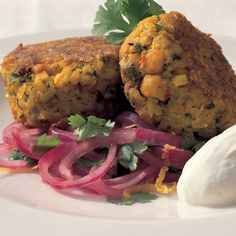 Vegetarian spiced chickpea cakes with red onion and coriander salad
