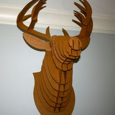 Cardboard deer head to decorate your wall... Get Preppy College Dorm Room Ideas like this on Uscoop.com!