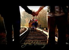 like the railroad idea. Again the four kids behind us.. dan and I holding hands.