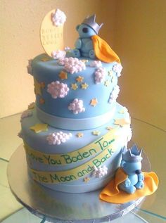 Love you to the Moon and Back baby shower cake adorned with sweet little bears with crowns and capes sitting among the moon and stars. Designed and created by Sweet Pea Cake Company of Colorado Springs.