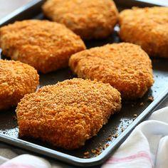 "Oven ""Fried"" Breaded Pork Chops Recipe Main Dishes with boneless center cut pork chops, kosher salt, large eggs, panko breadcrumbs, crumbs, grated parmesan cheese, sweet paprika, garlic powder, onion powder, chili powder, black pepper"