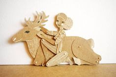 http://www.etsy.com/listing/84118370/girl-with-reindeer-articulated-paper?ref=fp_treasury_6