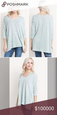 Light sage raw edge 3qtr sleeve tunic! A marled tunic top with 3/4 length sleeves. Oversized for a relaxed fit. Beautiful detail with revered stitching - side split and collar detail Tops Tunics