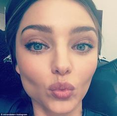 Kisses for all: Miranda Kerr showed off her flawless blemish free face on Friday as she pouted for the extreme close-up snap for her social media followers