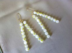 white /yellow dangle earrings by KaterinakiJewelry on Etsy Dangle Earrings, Dangles, My Etsy Shop, Delicate, Trending Outfits, Unique Jewelry, Handmade Gifts, Yellow, Spring