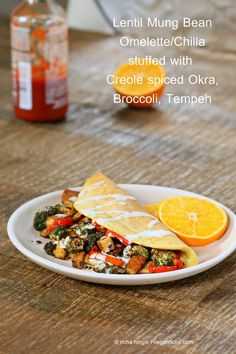 We can't think of one good reason why this Lentil Mung Bean Omelette/Dal Chilla made with Blackened Okra Tempeh Broccoli & Havarti shouldn't be your next meal.