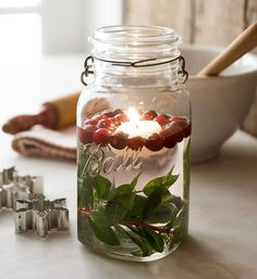 I love this idea of floating candles in mason jars for Christmas time! Noel Christmas, All Things Christmas, Winter Christmas, Christmas Crafts, Christmas Candles, Christmas Ideas, Christmas Centerpieces, Winter Holidays, Christmas Branches