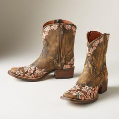 """VIOLETTA BOOTS--Like blossoms in the desert, these square-toe, embroidered women's cowboy boots have an unexpected beauty with delicate embroidery blooming over distressed leather. Imported. Exclusive. Whole and half sizes 6 to 10. 1-1/4"""" heel."""