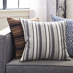 Tonal grey and white heathered stripes nod to the old-school charm of vintage wool blankets. Neutral palette layers with almost any color combo, adding welcome warmth and texture. Dual-sided design lets you flip between striped front and solid black back.