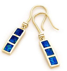 An ever popular design in our range, simplicity and refinement best described this pair of lovely hook earrings. With 6 stunning solid inlay opals sourced from quality opal mines in Coober Pedy, South Australia, our jewellers are tasked with crafting them into the simple yet elegant 14k Yellow Gold setting. The elongated design oozes class making them perfect for everyday wear. A perfect gift idea! #opalsaustralia