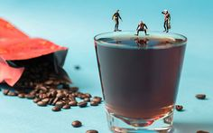Photographer Joseph Chien assembled these mini men diving into a warm cup of coffee, as part of a series of photos of the one-inch-tall figurines. The 37-year-old, of Taipei, Taiwan, says: 'I always try to image what it would be like to be as small as the figurines, and I wonder how I would interact with these everyday objects.' Picture: Joseph Chien/HotSpot Media