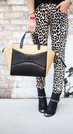 Go for a pop of print this holiday season! Leopard is always a great accent to any outfit.