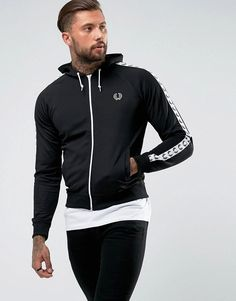 Get this Fred Perry's sport jacket now! Click for more details. Worldwide shipping. Fred Perry Sports Authentic Hooded Taped Track Jacket in Black - Black: Track jacket by Fred Perry, Bonded sweat, Drawstring hood, Zip fastening, Raglan sleeves, Functional pockets, Fitted trims, Regular fit - true to size, Wipe with a damp sponge, 54% Polyester, 46% Cotton, Our model wears a size Medium and is 192cm/6'3.5 tall. Fred Perry's authentic menswear collection is heavily influenced by the brand's…