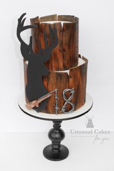 Nice cake for a hunting enthusiast. Gun isn't proportionate, maybe make it bigger or remove it altogther.