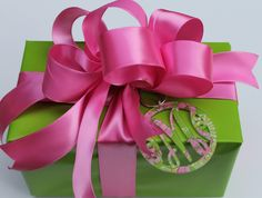 LOVE!!! Bebe'!!! Bright green paper with bright pink satin bow and ribbon and pink and green print monogram medallion trim!!!
