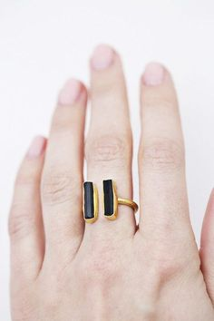 Best Accessories & Jewelry Ideas  :    I love the black and gold combination on this little ring.   https://greatmag.net/fashion/accessories/jewelry/best-accessories-jewelry-ideas-i-love-the-black-and-gold-combination-on-this-little-ring/