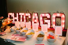 "my Chicago hot dog bar ~ it was a PERFECT midnight snack for my wedding! I DIY'd the marquee letters- so simple! Just purchase papier-mache letters from Joann's (I used 12""), cut one side off with exact-o knife (they tear off easily!), poke holes for lights, spray paint, screw in mini bulb lights (Ikea has great ones) and illuminate! These marquee lights are better in real life- they really are quite impressive!"