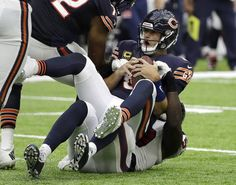 Chicago Bears quarterback Jay Cutler (6) is sacked by Houston Texans outside…