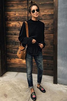 Sweaters, jeans, and embroidered loafers.