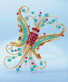 A Retro Diamond, Ruby and Turquoise Butterfly Brooch, by Van Cleef & Arpels. Photo: Christie's Images Ltd 2012 Designed as a butterfly with a circular-cut ruby and diamond body, extending sculpted gold wings and antennae with cabochon turquoise, circular-cut diamond and ruby detail, mounted in gold, 1942, in a Van Cleef & Arpels green leather case; Signed Van Cleef & Arpels, N.Y., 3292